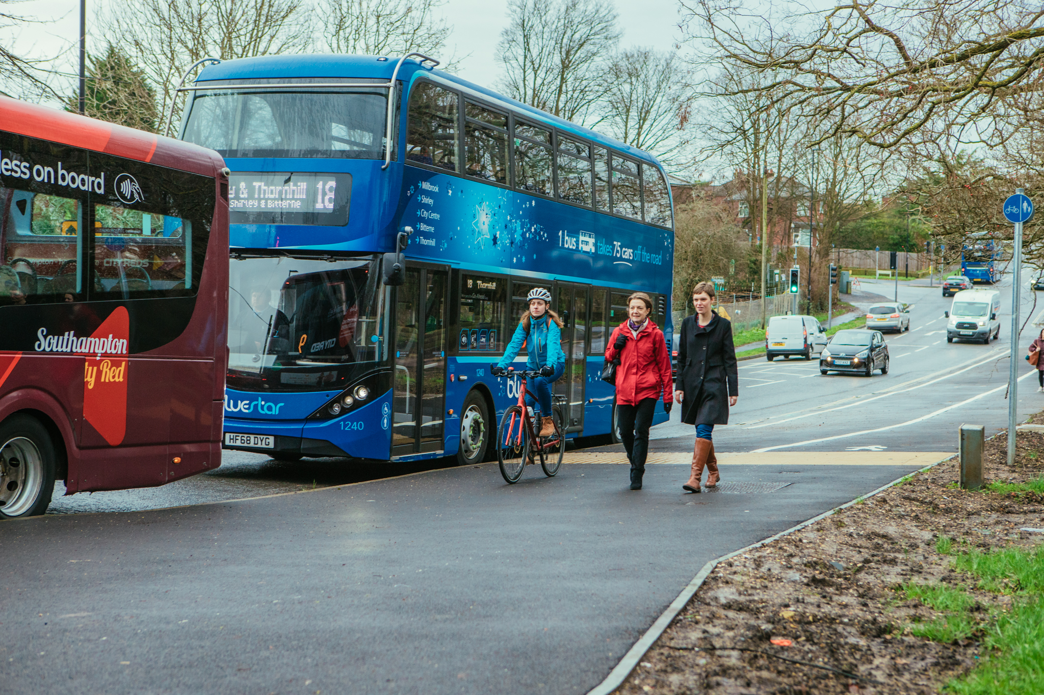 picture of bluestar bus and a cityred bus